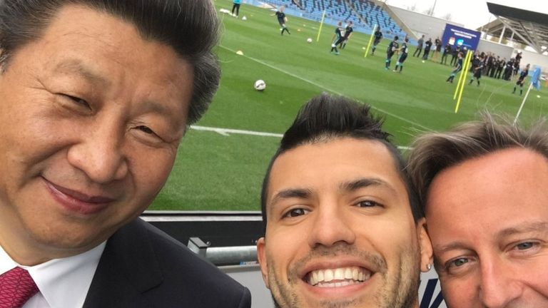 Sergio Aguero poses for a photo with China's president Xi Jinping and former prime minister David Cameron