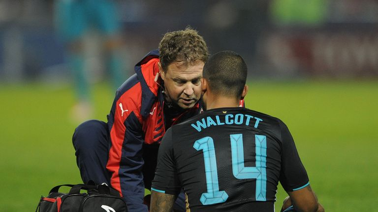 Theo Walcott was injured during the 3-0 defeat to Sheffield Wednesday in the Capital One Cup