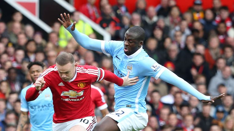 Wayne Rooney tussles with Yaya Toure at Old Trafford