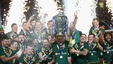 Cameron Smith, the captain of Australia, lifts the trophy after his side's 34-2 win over New Zealand