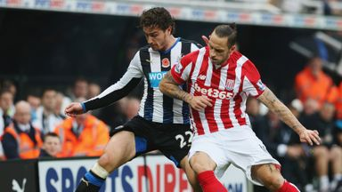 Daryl Janmaat tangles with Marko Arnautovic during Newcastle