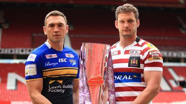 Leeds Rhinos captain Kevin Sinfield (left) and Wigan Warriors captain Sean O'Loughlin pose with the Super League trophy at Old Trafford