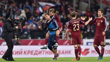 Russia's Vasili Berezutski, Aleksandr Kokorin, Dmitri Kombarov and Fedor Smolov  celebrate after securing their spot at Euro 2016.