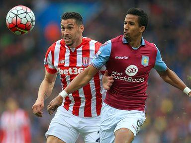 Stoke City's Geoff Cameron (left) and Aston Villa's Scott Sinclair battle for the ball