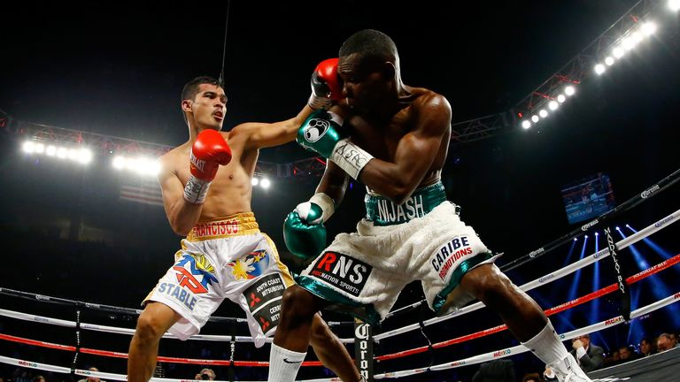 Drian Francisco throws a left to the head of Guillermo Rigondeaux (right)