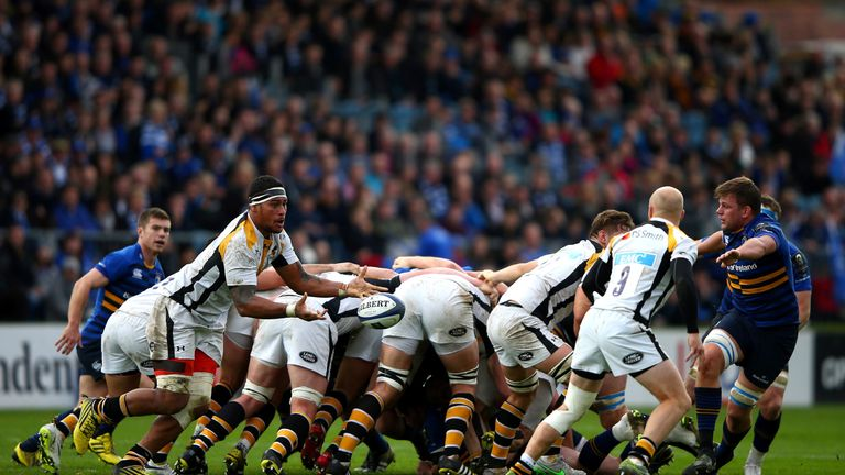 Nathan Hughes passes the ball from the back of a scrum