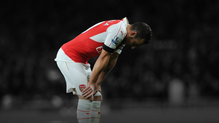 Arsenal's Santi Cazorla was replaced at half-time after suffering dizziness.