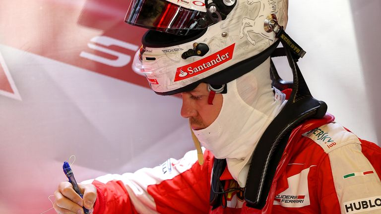 Sebastian Vettel, seen here making notes in P2, was the lead Ferrari on Friday, but finished only fifth on the timesheet