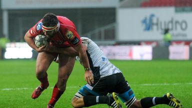 Scarlets' Emyr Phillips is tackled by Zebre's Dries van Schalkwyk