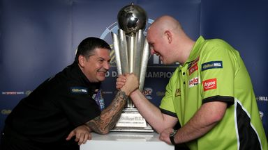 Michael van Gerwen and Gary Anderson pose with the Sid Waddell Trophy
