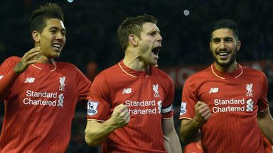 James Milner (middle) celebrates after scoring from the penalty spot for Liverpool