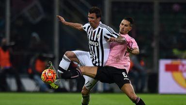 Mario Mandzukic (left) of Juventus is challenged by Edoardo Goldaniga of Palermo