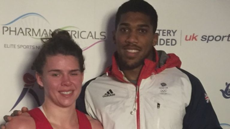 Savannah Marshall receives her prize from pro fighter Anthony Joshua