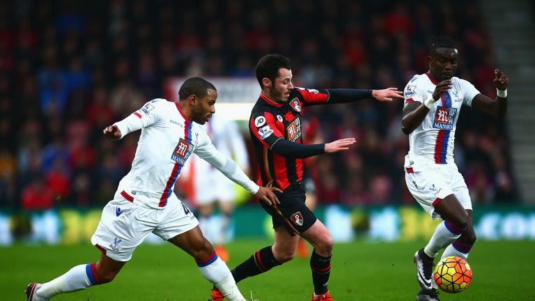 Adam Smith challenges Pape Souare (R) and Jason Puncheon of Crystal Palace