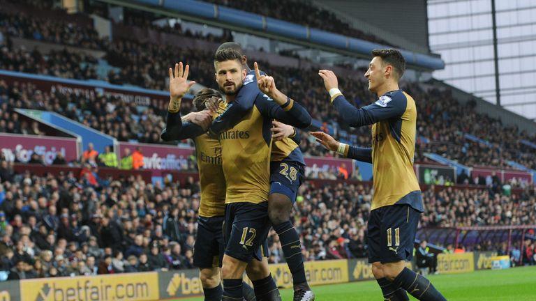 Olivier Giroud celebrates scoring the opening goal for Arsenal against Aston Villa