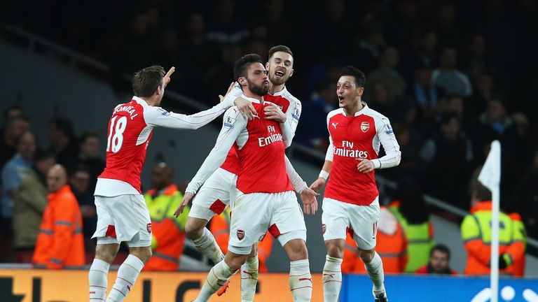 Olivier Giroud of Arsenal celebrates scoring his team's second goal with team mates during the Barclays Premier League match against Man City