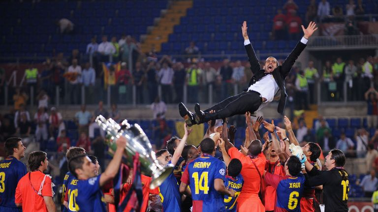 Guardiola is thrown into the air after Barcelona's 2009 Champions League triumph