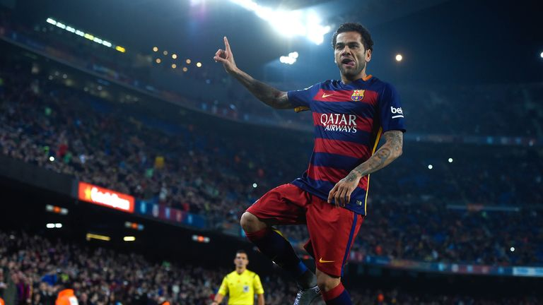 Dani Alves is named at right back