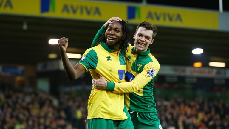 Dieumerci Mbokani (left) celebrates Norwich's second against Aston Villa