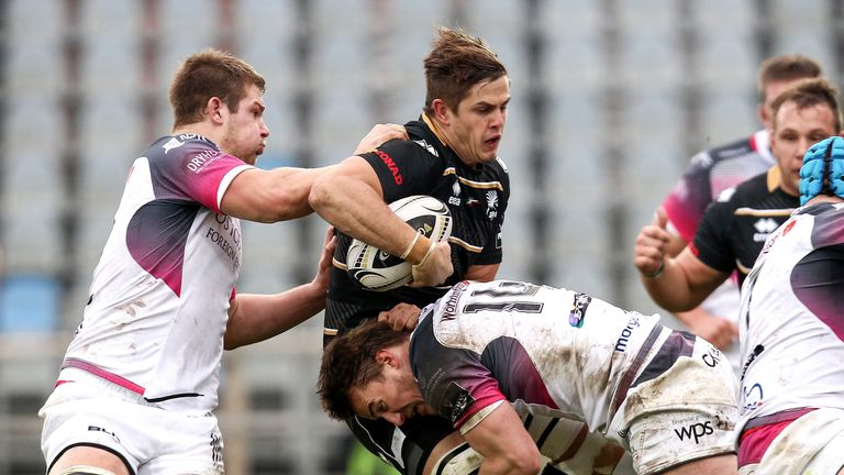 Zebre's Johan Meyer tackled by Jeff Hassler of Ospreys