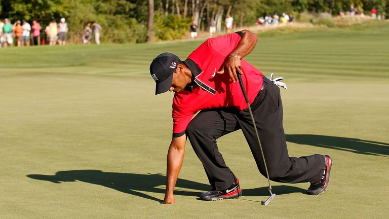 The American struggled to bend over during the final round of the Barclays