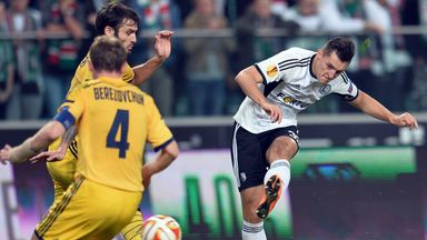 Legia Warsaw's Michal Zyro (R) will begin life at Wolves in January