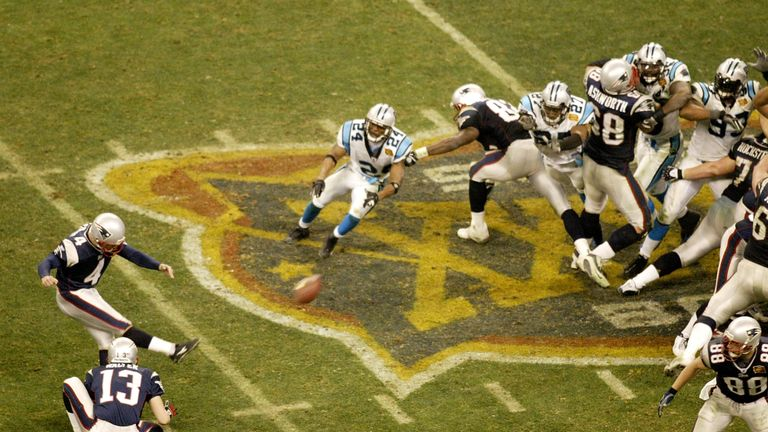 Adam Vinatieri of the Patriots kicks the game-winning field goal against the Panthers