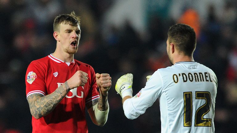 Bristol City's Aden Flint celebrates victory with Richard O'Donnell