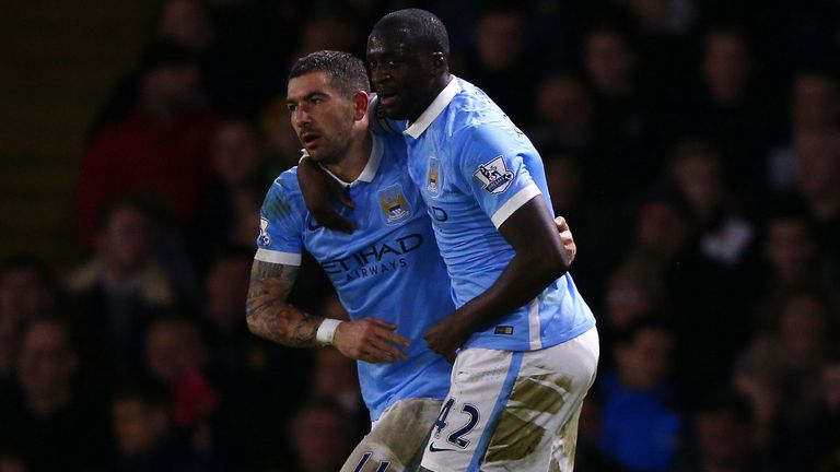Yaya Toure celebrates with Aleksandar Kolarov