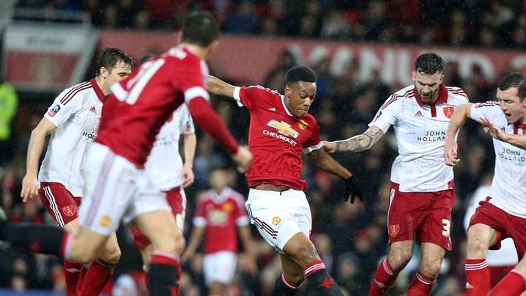 Anthony Martial tries to force his way through in the first half against Sheffield United