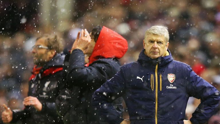 Arsene Wenger reacts after Liverpool's third goal
