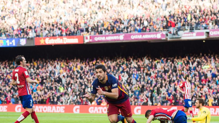 Luis Suarez celebrates after scoring for Barcelona against Atletico Madrid