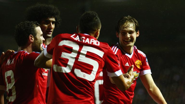 Daley Blind (right) celebrates with Jesse Lingard (35) and team-mates after United's second