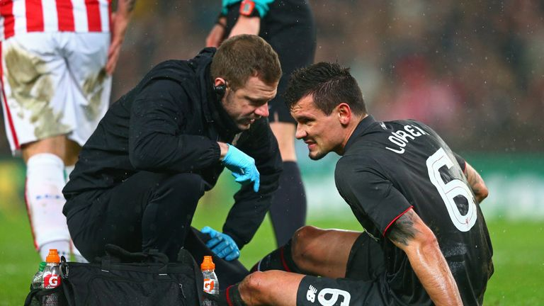 Dejan Lovren is treated before his substitution at the Britannia Stadium