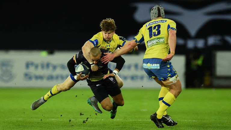 Ospreys wing Eli Walker is tackled by David Strettle and Jonathan Davies (right) of Clermont