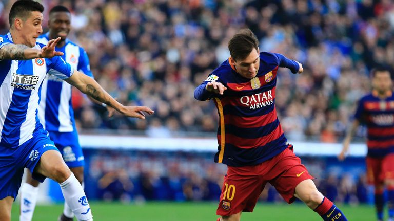 Lionel Messi takes on Espanyol defender Enzo Roco