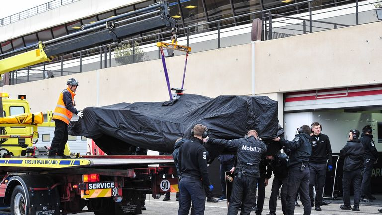 The car of Stoffel Vandoorne is recovered to the pits after stopping on track