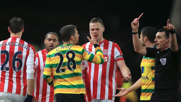 Norwich midfielder Gary O'Neil was sent off for a poor challenge on Ibrahim Afellay