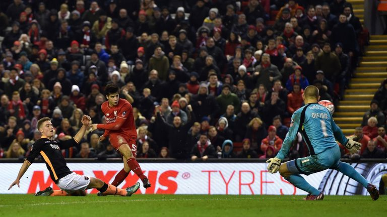 Joao Teixeira scores Liverpool's third goal against Exeter