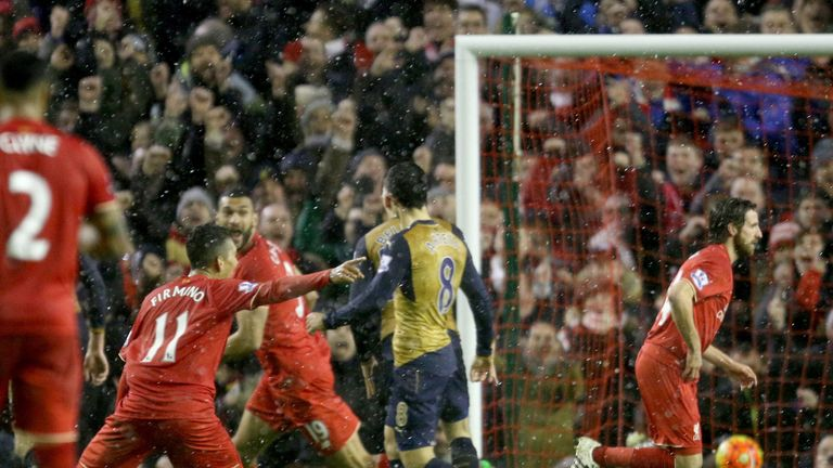 Liverpool's Joe Allen celebrates his dramatic late equaliser against Arsenal at Anfield
