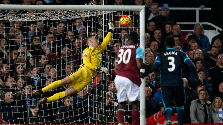Manchester City goalkeeper Joe Hart (left) saves a shot