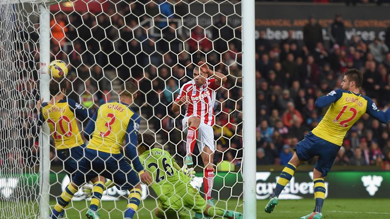 Jon Walters scores for Stoke during a 3-2 win over Arsenal that led to Arsene Wenger being harangued by his own club's supporters