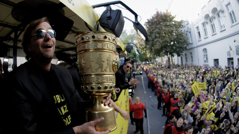 Klopp on the Dortmund bus with the DFB Pokal Cup after their 2012 double