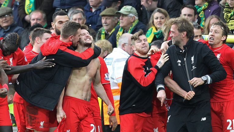 Liverpool celebrate following Adam Lallana's dramatic winner