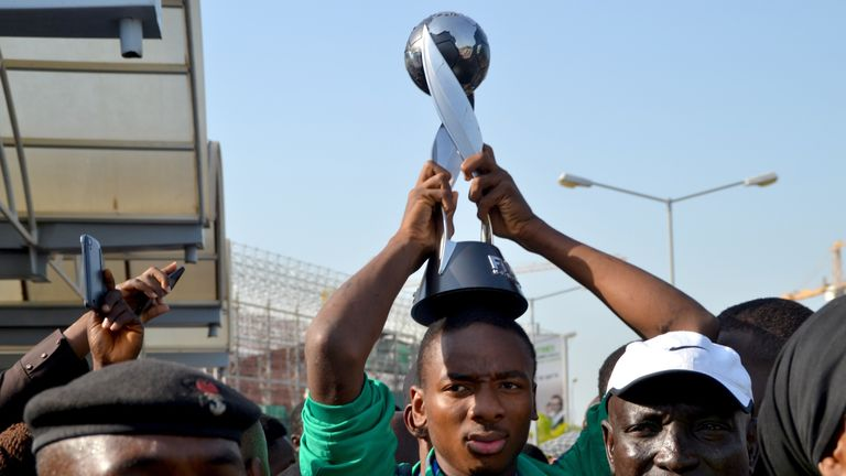 Nigeria's Kelechi Nwakali carries the Fifa U17 World Cup trophy on his head