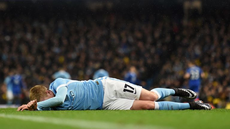Manchester City's Belgian midfielder Kevin De Bruyne lies injured on the pitch before being stretchered off
