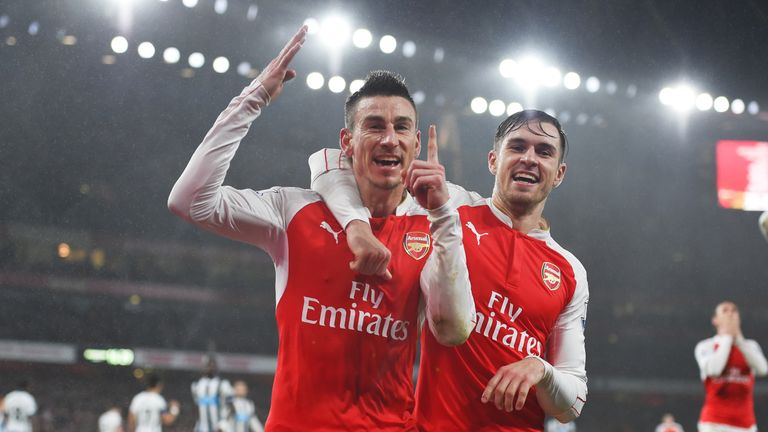 Laurent Koscielny (left) celebrates netting the winner against Newcastle