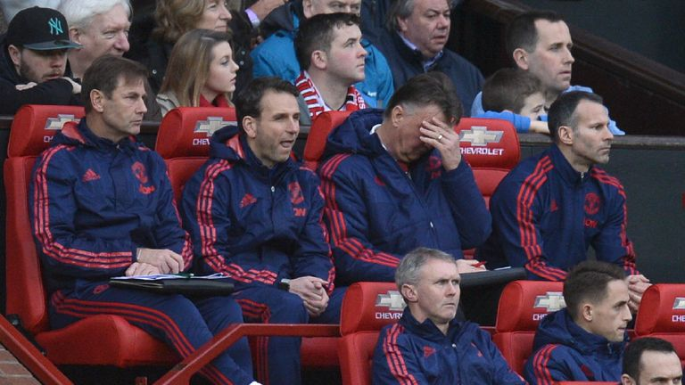 Louis van Gaal covers his eyes during a low-key first half of Manchester United's game against Southampton