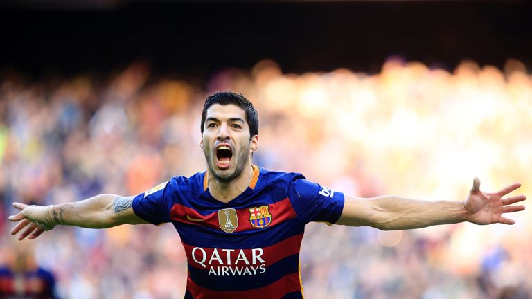 Barcelona forward Luis Suarez celebrates after scoring against Atletico Madrid