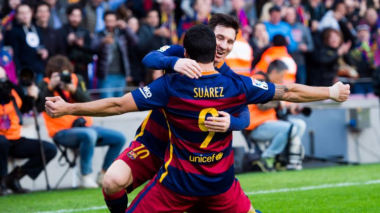 Luis Suarez and Lionel Messi celebrate